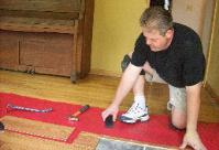Marty Schabel installing laminate flooring
